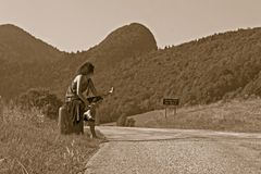 Woman making of hitch-hiking Royalty Free Stock Image