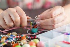 Woman making home craft art bijouterie Royalty Free Stock Image