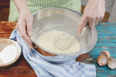 Woman making homemade pancakes Stock Image