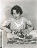 Woman making a hooked rug Stock Photo