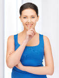 Woman making a hush gesture Stock Image