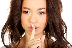 Woman making a hush gesture. Stock Photography