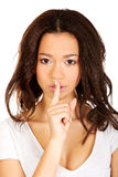 Woman making a hush gesture. Royalty Free Stock Image