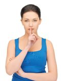 Woman making a hush gesture Royalty Free Stock Images
