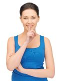 Woman making a hush gesture Stock Images