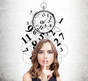 Woman making a hush sign, time management Stock Photos