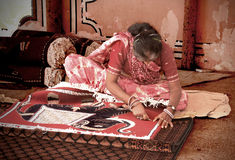 Woman making Indian carpet Stock Photography