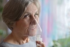 Woman making inhalation Royalty Free Stock Photos