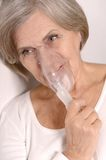 Woman making inhalation. Royalty Free Stock Photography