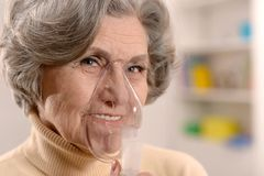 Woman making inhalation Royalty Free Stock Image
