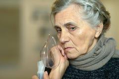 Woman making inhalation Stock Photo