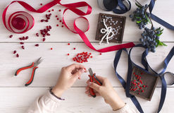 Woman making jewelry, home workshop, hobby Royalty Free Stock Images