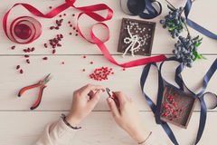 Woman making jewelry, home workshop, hobby Royalty Free Stock Photo
