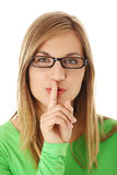 Woman making a keep it quiet gesture Royalty Free Stock Images