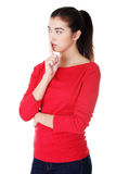Woman making a keep it quiet gesture Stock Photo