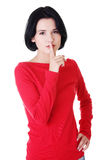 Woman making a keep it quiet gesture Royalty Free Stock Photo