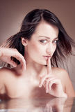 Woman making a keep it quiet gesture. Stock Photo