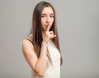 Woman making keep it quiet gesture Stock Photography