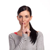 Woman making a keep it quiet - isolated Royalty Free Stock Photos