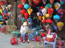 Woman making lanterns in front of their shop at market stock image