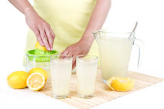 Woman making lemonade. With white background Stock Photo