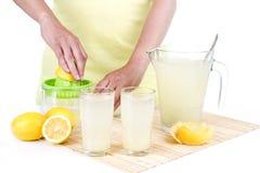 Woman making lemonade Stock Photo