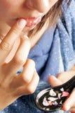 Woman making a lips treatment Stock Photography