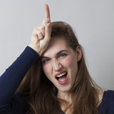 Woman making loser sign Royalty Free Stock Image