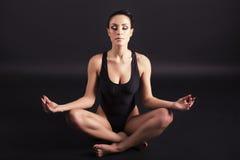 Woman making lotus pose Stock Images
