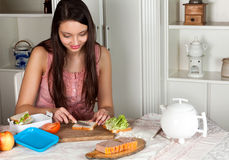 Woman making a lunchbox Stock Images