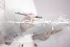 Woman making magic effect - flash lightning. The concept of electricity, high energy. Royalty Free Stock Image
