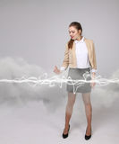 Woman making magic effect - flash lightning. The concept of electricity, high energy. Royalty Free Stock Images