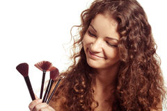 Woman is making make-up. With brush tool Stock Photo