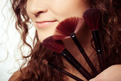 Woman is making make-up. With brush tool Royalty Free Stock Images