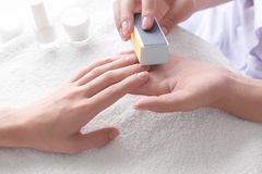 Woman making manicure Royalty Free Stock Photography