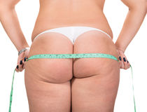 Woman making measure of  hips Royalty Free Stock Photography