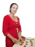 Woman making meat dumplings Stock Image
