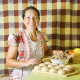 Woman making meat dumplings Royalty Free Stock Images
