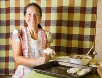 Woman making  meat dumplings Stock Photos