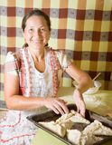 Woman making  meat pasty Stock Images