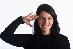 Woman making a military greet. On white background royalty free stock photography