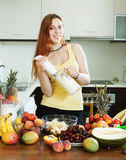 Woman making  milkshake with blender from fruits Royalty Free Stock Photos