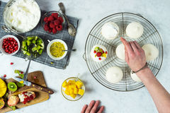 Woman Making Mini Tropical Fruit Pavlovas Royalty Free Stock Image