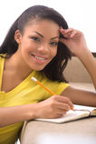 Woman making notes. Royalty Free Stock Images