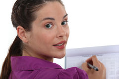 Woman making notes Royalty Free Stock Photography