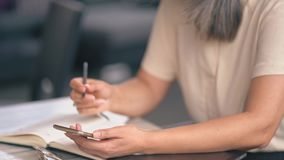 The Woman Is Making Notes In Her Notepad stock footage