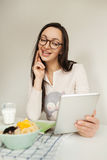 Woman making notes with tablet and healthy food on table Royalty Free Stock Photography