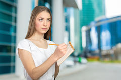 Woman making notes Stock Photography