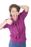 Woman making ok sign with a smile with funny face Royalty Free Stock Images