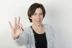 woman is making OK sign Royalty Free Stock Photography